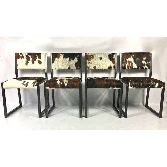 Fantastic set of FOUR custom upholstered pony skin chairs, with hand blackened steel base by Brooklyn based furniture...