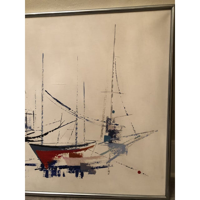 Painting features variety of colors depicting abstract sailboats. Framed in simple silver metal frame. In very good...