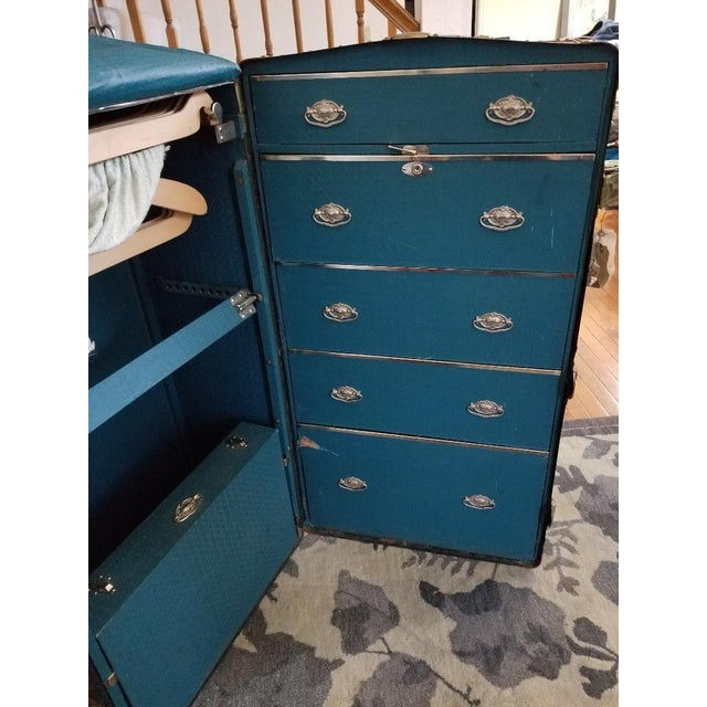 Own a priceless piece of American military history! Antique Hartmann steamer trunk. Item features full wardrobe interior,...