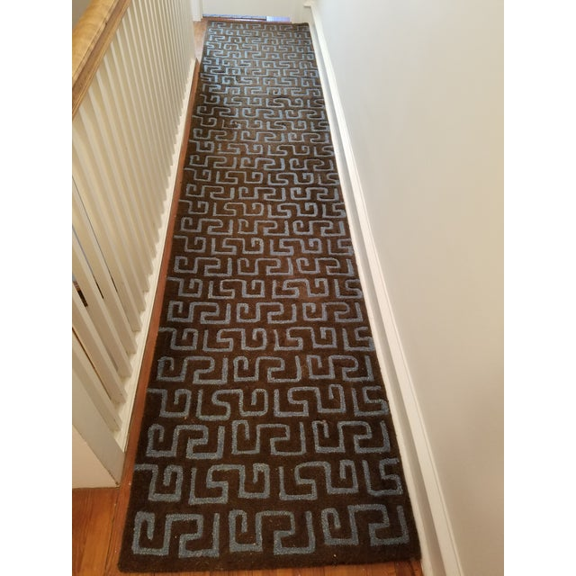 "30"" wide by 120"" long wool viscose runner has a thick brown pile with a Greek Key-ish style pattern in blue. Lightly worn..."