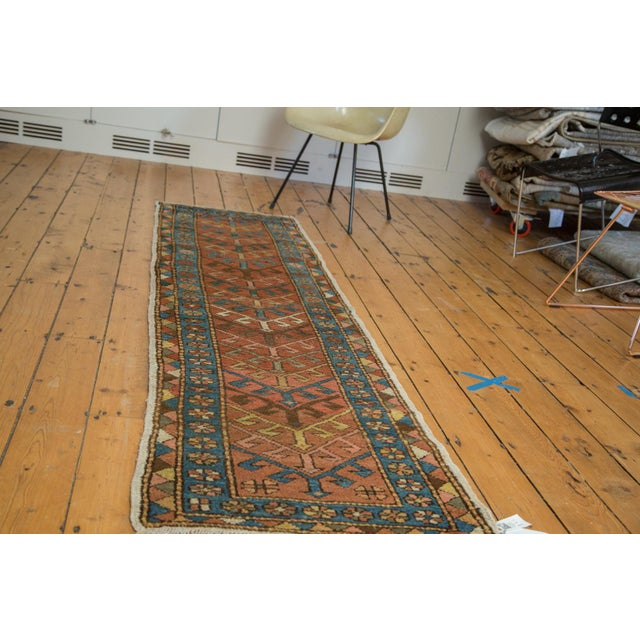 Fun and funky geometric rug runner with a centralized arrowhead design of implied movement. Inner border comprised of...