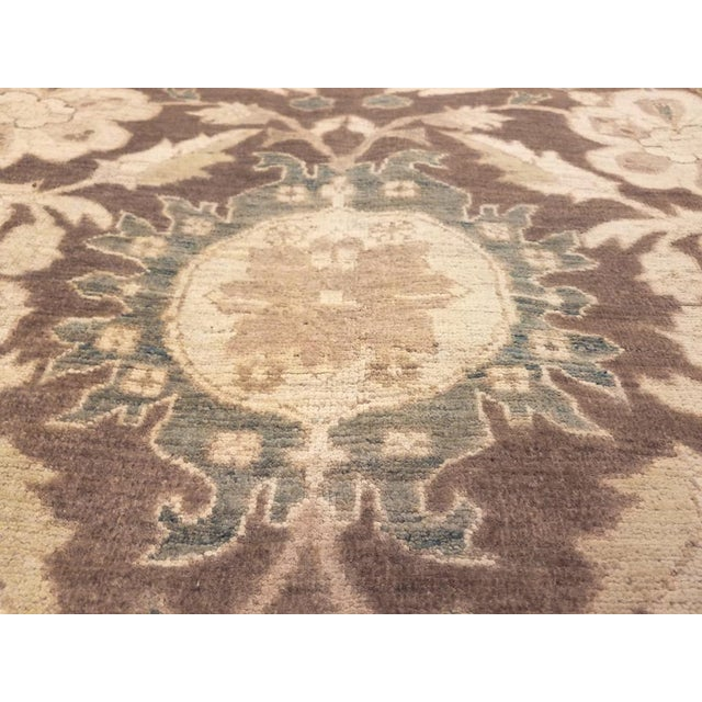 Add some versatility and warmth to your living space with this charmingly beautiful rug hand-knotted by talented craftsmen...