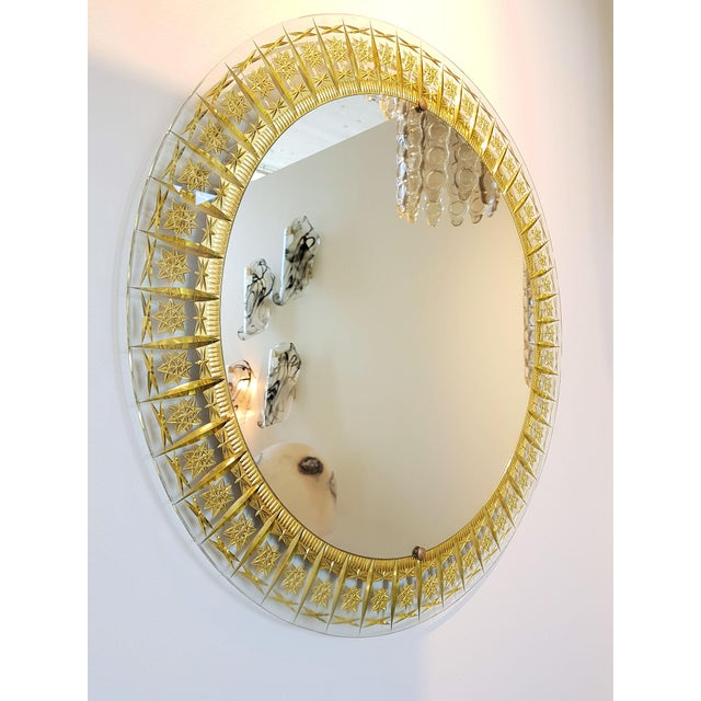 Cristal Arte mid century modern wall mirror, round shape. Frame in carved glass w/gold leaf inclusions. Original mirror....