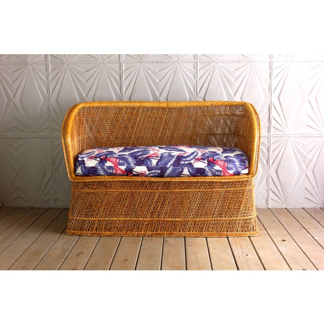 Very cool vintage woven cane/rattan/wicker sofa or settee. It is in excellent vintage condition overall. The cushion has...