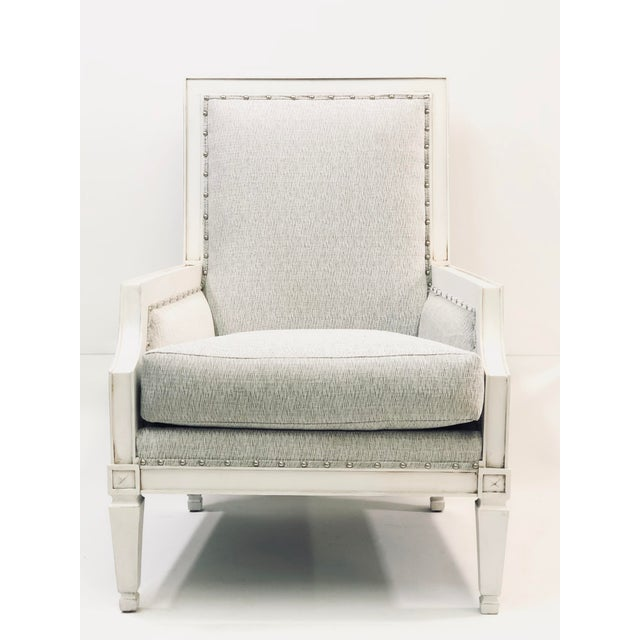 With their dramatic white wood angles, these accent chairs will draw in natural light and the eyes of your guests. The...