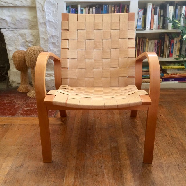 Lovely, simple bent plywood armchair with tan webbing in the style of Bruno Mathsson. In great vintage condition. Webbing...