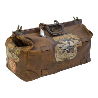 Early 20th C. Distressed Leather Luggage Bag With Original Travel Stickers and Brass Accents, C. 1920s
