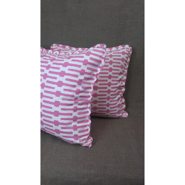 Pair of Annie Selke throw pillows in Links cotton Print, fuchsia on cream background, flat welt with pinched corner and...