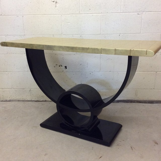 Fabulous deco style gold leaf and black lacquer console table Is ready for your Hollywood Regency home! Black and gold is...