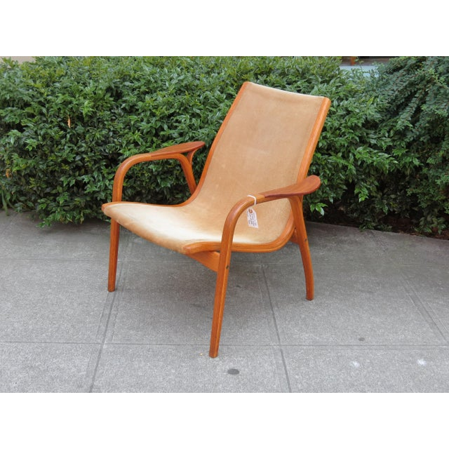 Vintage MID CENTURY MODERN Laminett Chair designed by Yngve Ekström in 1956 in tan suede. This is the little version of...