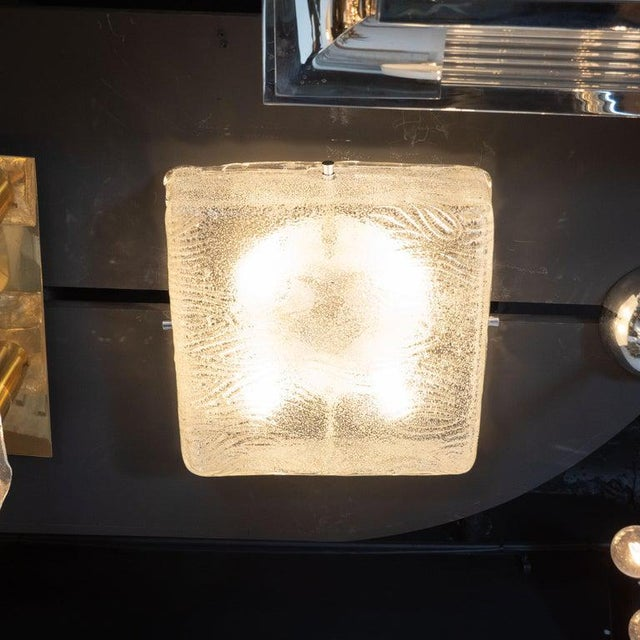This refined and austere Mid-Century Modern flush mount was realized in Germany, circa 1960. It features a square body...