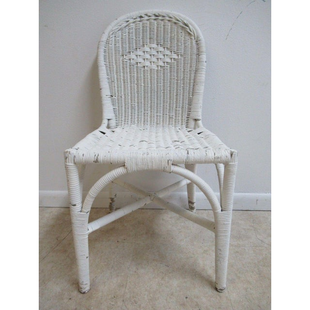 """An antique wicker patio side chair. Great shape... some small breaks in wicker... some scratches. Seat height 17""""."""