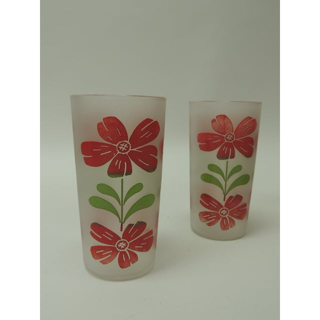 Vintage Festive Floral Hand painted set of four glasses with floral motifs in shades of red and green. Frosted glass....