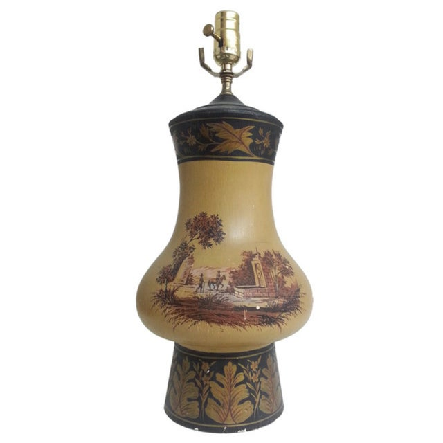 Give your living room a taste of the Old West with the yellow orca wooden Urn Lamp which been painted with leave design...