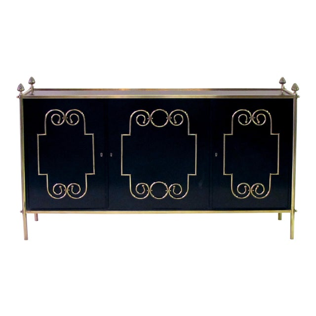 An exquisite American mid-century custom-made black lacquer 3-door sideboard/buffet with applied brass scroll work; by Daniel Jones, Inc. New York For Sale