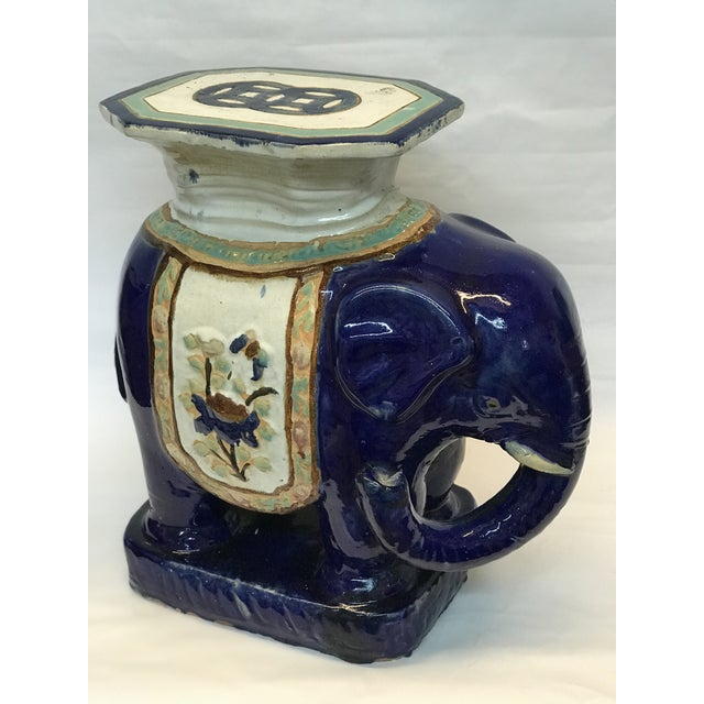 "Item Overview • Vintage item • Material: Glazed ceramic Item Details Ceramic elephant stool measures 23""H x 23""L x 13""D"