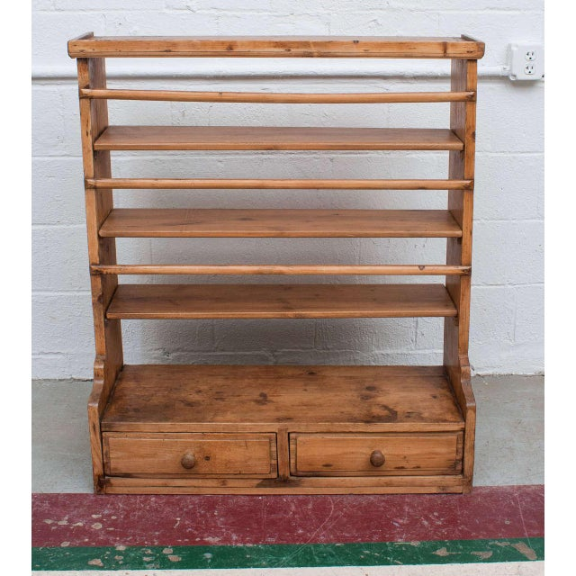 A charming two-drawer hanging plate rack featuring all morticed and dovetailed construction with four shelves for storing...