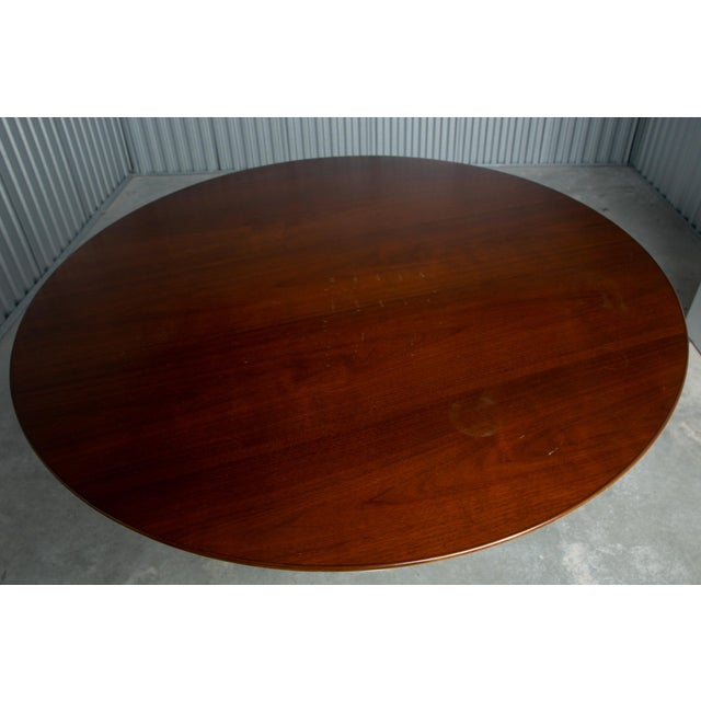 """47"""" Round Tulip Dining Table by Saarinen for Knoll. Walnut top with white tulip base. Made in USA in 2012. Dimensions:..."""