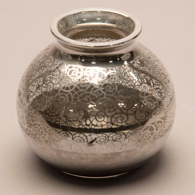 Circa 1950s glass vase with round, globe form with decorative, nautilus-form design in silver overlay. Unknown maker....