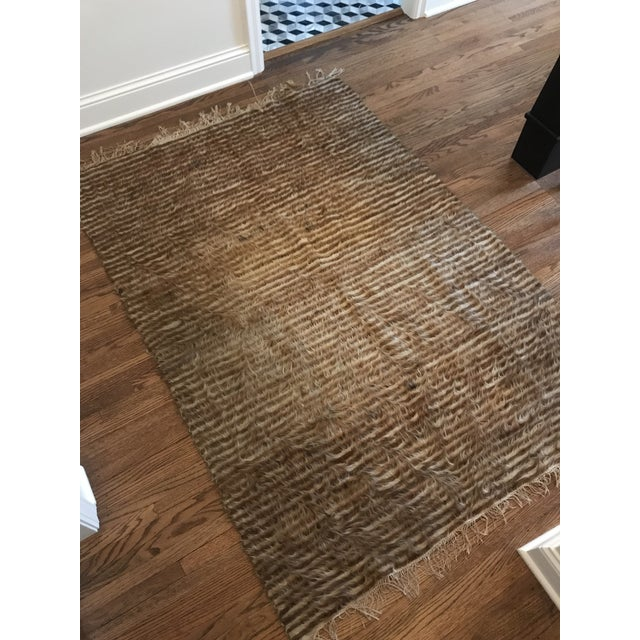 Beautiful Vintage stripped goat hair rug. in ivory and camel color way. Fringe at sides. Circa 1960. This could be used as...