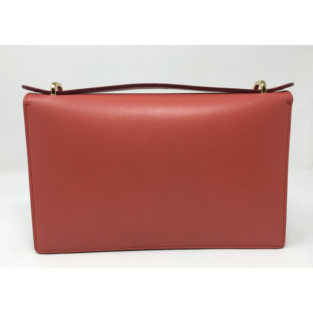 This structured small, stylish Ferragamo bag in Rouge leather is perfect for warm weather. Flip lock closure with ability...