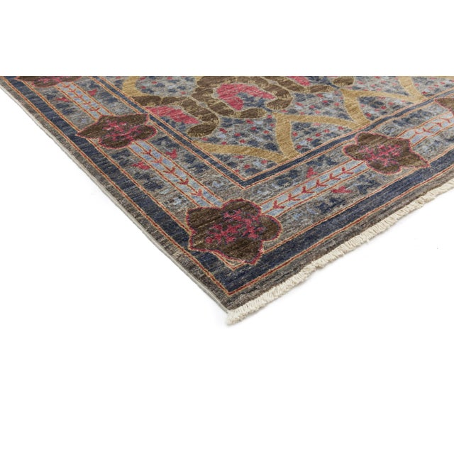 A hand knotted rug inspired by designs of the Arts & Crafts movement. The Arts and Crafts designs made popular by English...