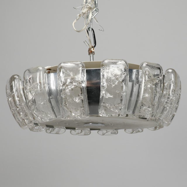Circa early 1970s flush mount light fixture by Kalmar. Round fixture has a thick satin glass cover and clear icicle glass...