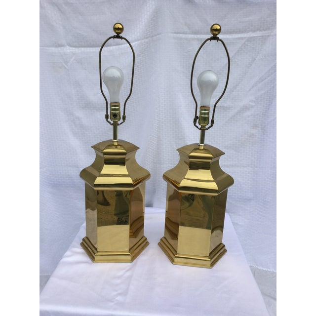 Nice pair of 1970's modern brass table lamps with original finials, these pieces are in good vintage and working condition...