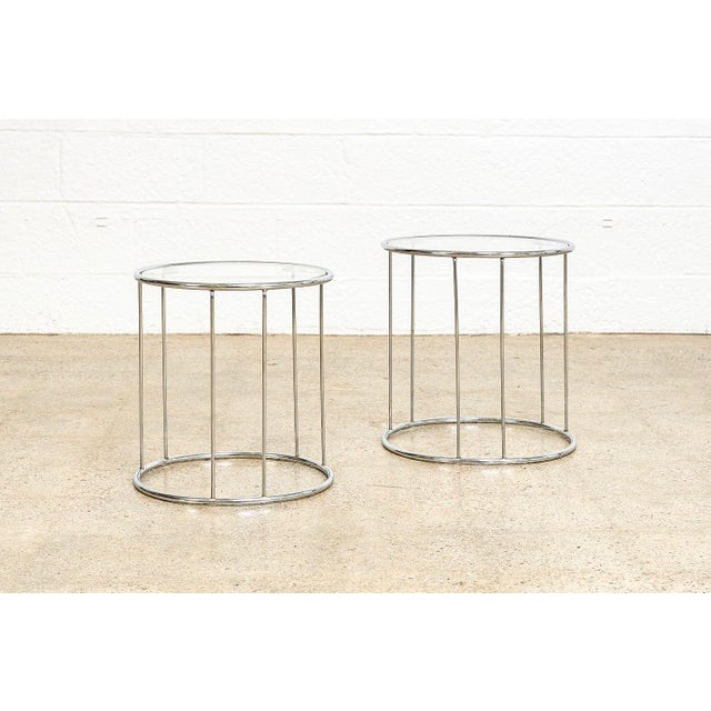 This two-piece set of vintage mid century modern Milo Baughman style round nesting tables is circa 1970. The elegant,...