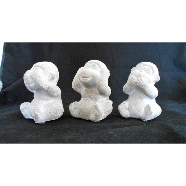"Three cement monkey sculptures depicting the famous Japanese pictorial maxim, embodying the proverbial principle ""see no..."