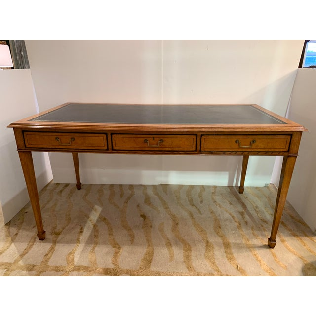 An elegant custom mahogany writing desk having 3 smoothly functioning drawers on one side, beautifully finished on the...