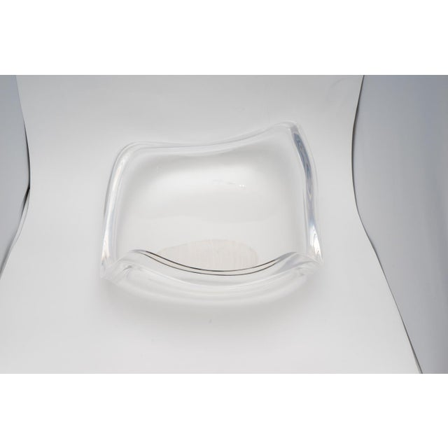This stylish freeform Lucite bowl dates to the 1970s and was created by Ritts of LA and it has been professionally...