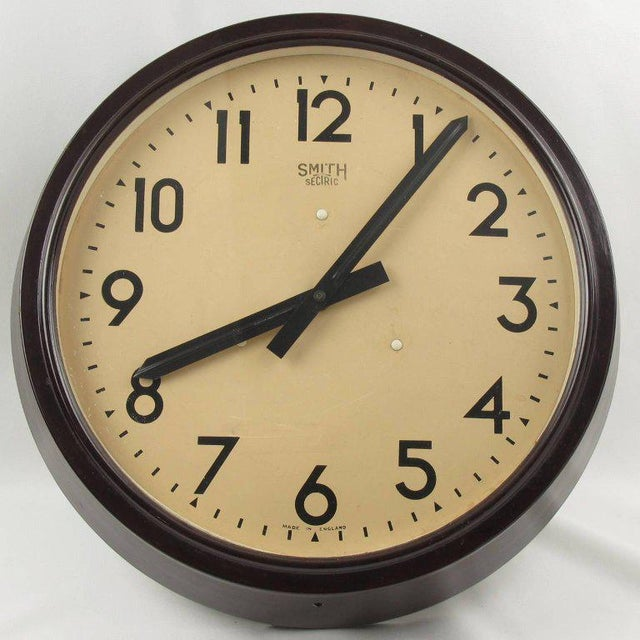 Huge industrial Art Deco wall clock by Smith, England. Brown marble Bakelite frame. Clock face protected with glass. This...