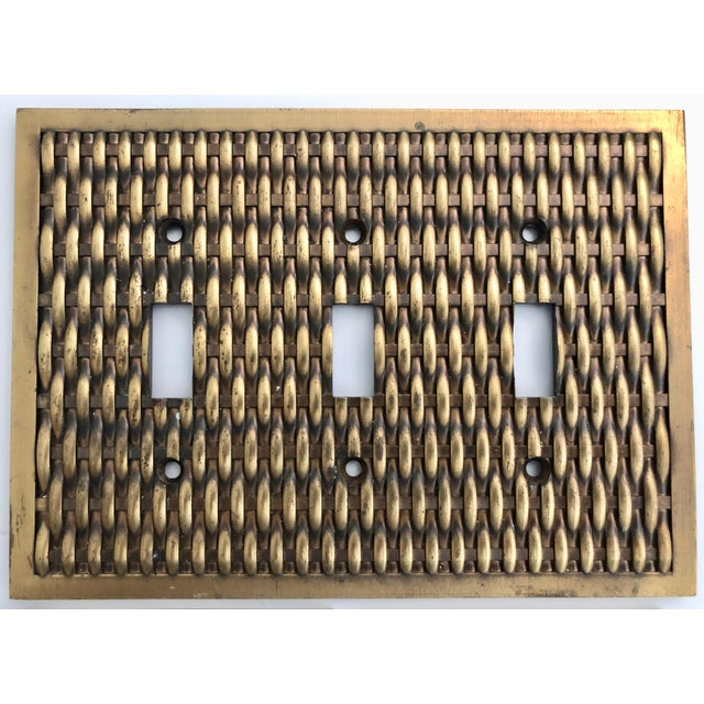 This vintage set of two outlet covers and one switch plate cover are made of solid brass in a basketweave pattern. Great...