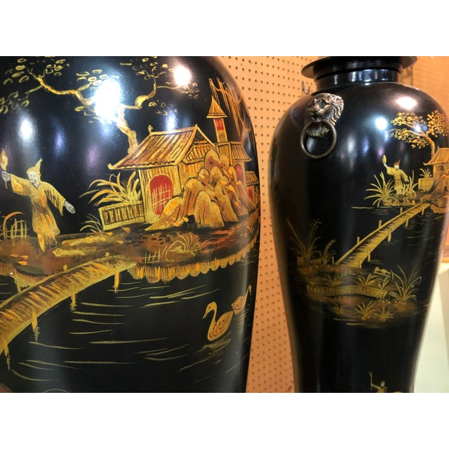 Pair of Large Chinoiserie Painted Ceramic Lidded Urns from a Palm Beach Estate. Great Lion pulls.