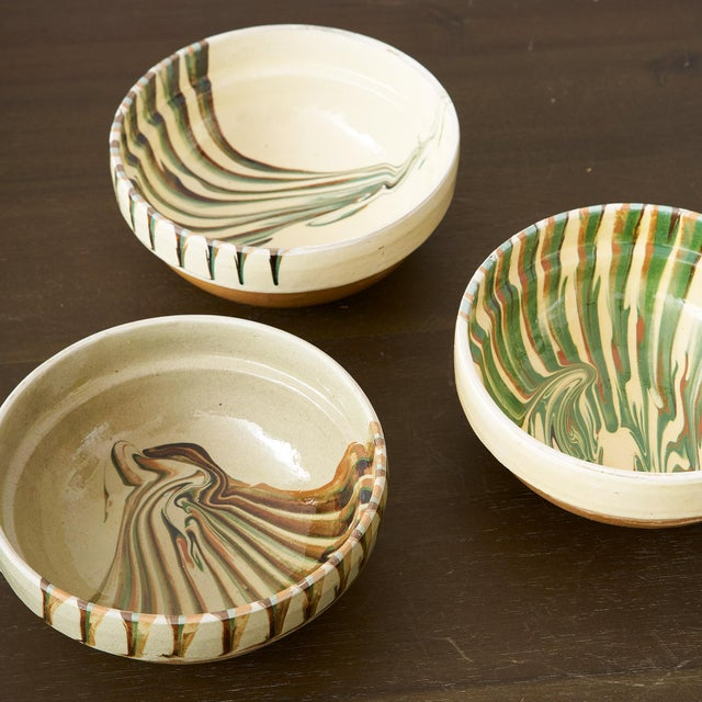 The Brown, Tan, ivory and green handpainted Bowls are perfect for a touch of color in any interior. The hand-painted...