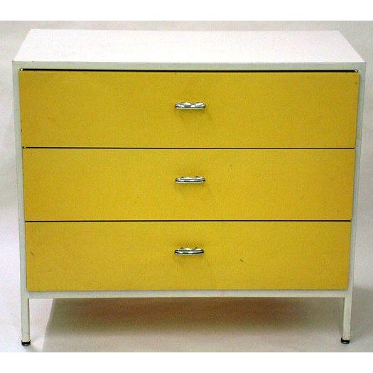 A pair of three drawer chests from the Steel Frame series by George Nelson for Herman Miller with white enameled metal...