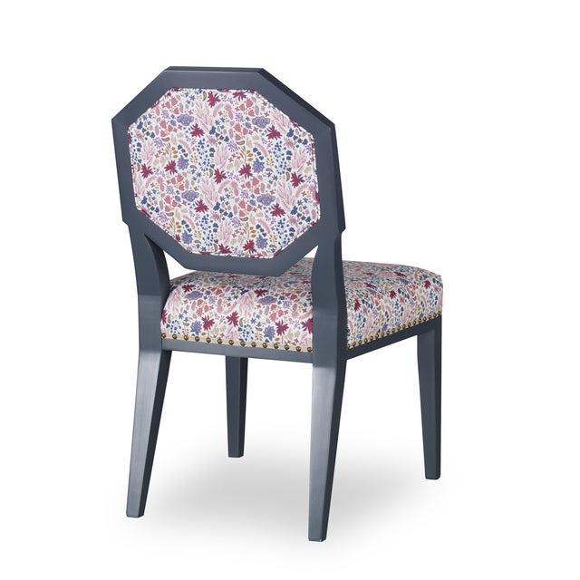 The frame is a midnight blue hue with a high sheen finish. Upholstered in House of Harris Cambridge, Jewel fabric with...