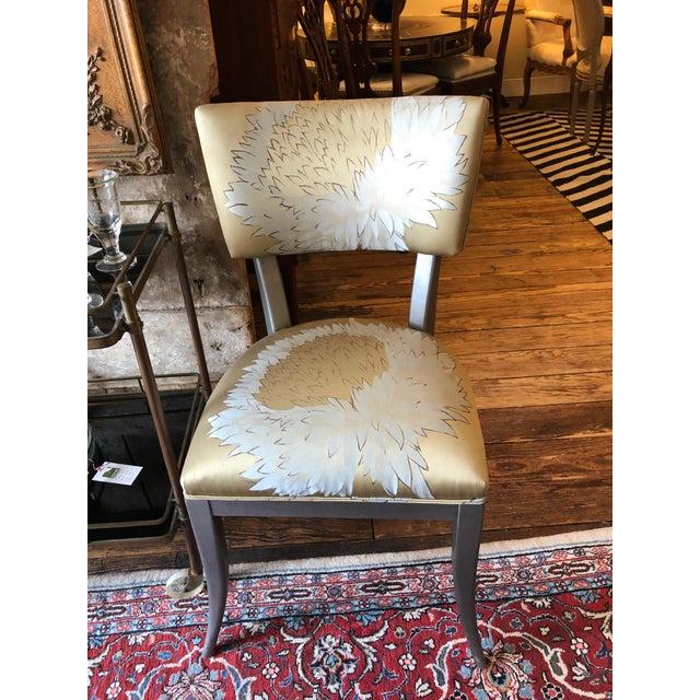 A gorgeous designer custom klismos inspired set of 8 dining chairs having silver glazed wood and stunning Jim Thompson...