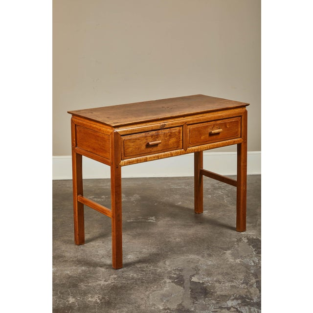 An early 20th century Vietnamese French Colonial console with two drawers. Circa 1920.