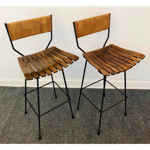 A great pair of 1960's Arthur Umanoff tall bar stools designed for Raymor. The tall pair feature the Mid-Century Modern...