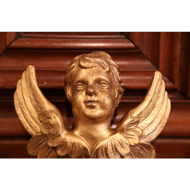 Elegant antique sculpture from France; crafted circa 1860, the wall hanging sculpture features a hand carved cherub face...