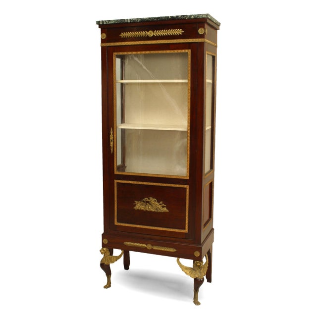 French Empire style (19th Century) mahogany single door display/vitrine cabinet with gilt bronze trim and front sphinx...