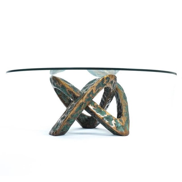 Very rare bronze cast coffee table, circa 1955. Heavy handmade Mobius knot made from bronze, partially patinated partially...