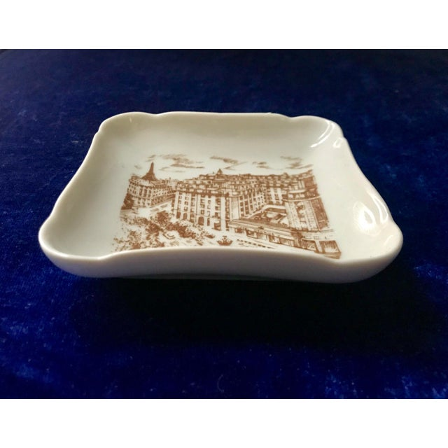 Lovely vintage dish featuring advertisement for the Hotel George V in Paris France. Lovely piece that could be used as a...