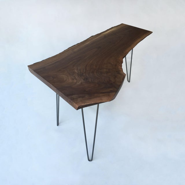 Lovely walnut live edge side table. This Mid-Century Modern piece is mounted on hairpin legs. This is a solid walnut live...