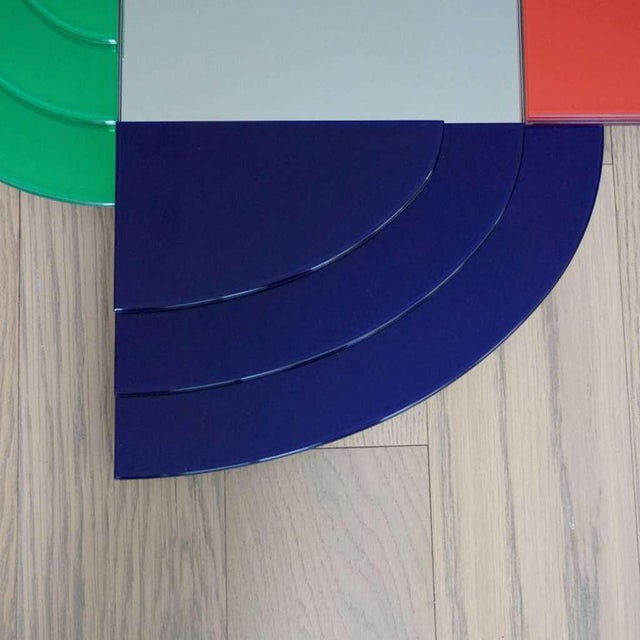A modern polychromatic mirror designed by Ettore Sottsass of the post-modernism movement, part of the series Gli Specchi...