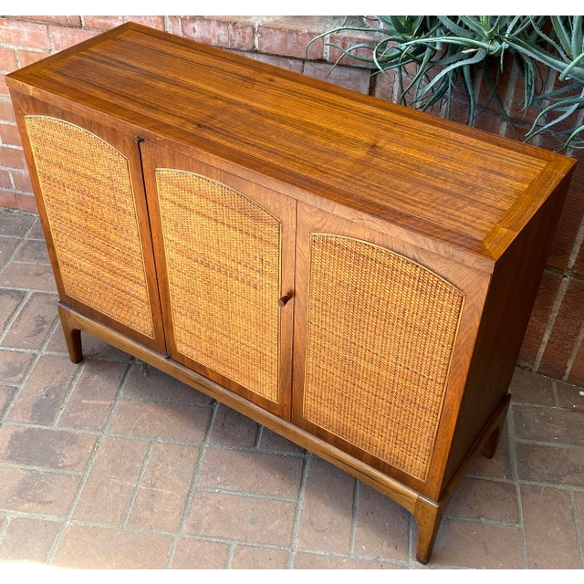 """1960s Lane """"Rhythm"""" walnut and cane small cabinet is super sweet. Handy storage with style - the one door design is very..."""