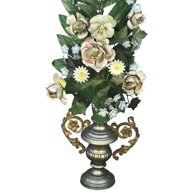 Large pair of tole painted flowers in metal urns.