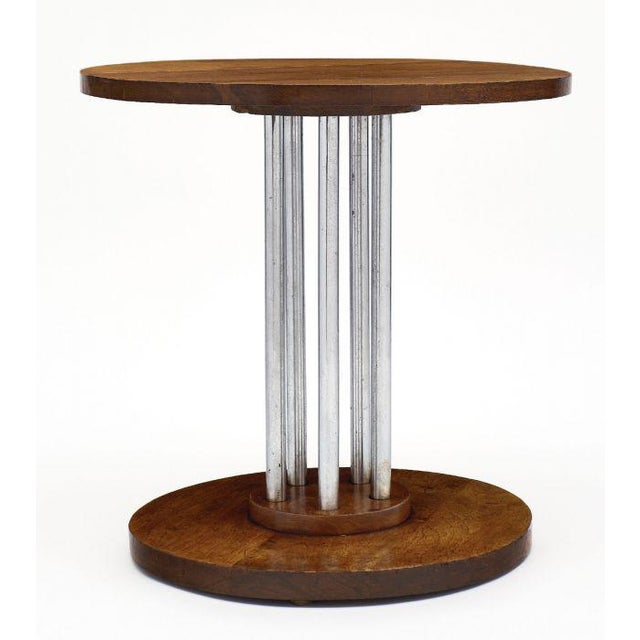 French architectural oak gueridon featuring a solid oak planked top and base connected with five chromed steel tubes. We...